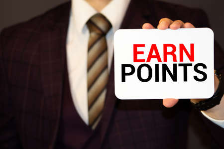 Word, writing, text Earn Points. Conceptual photo Loyalty Reward Benefit Program For Earning Customer Point written Sticky Note Paper Holding Hand with Finger. Imagens