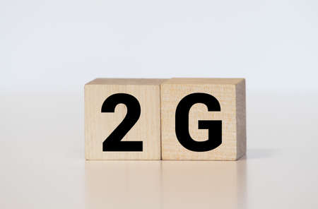 the word of 2G on wooden cubes. Imagens