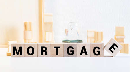 MORTGAGE word concept on wodden blocks, business concept.