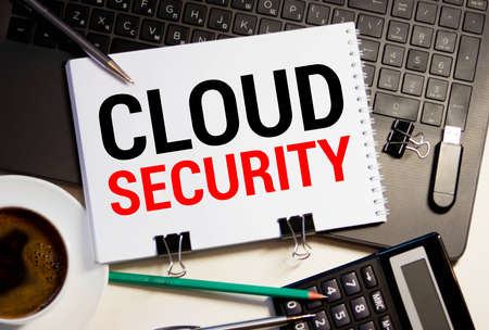 CLOUD SECURITY words written on a piece of paper.