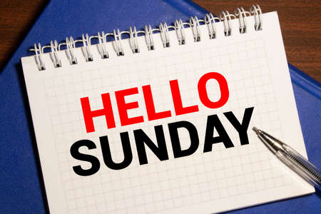 Hello Sunday word on notebook. Business conceptual Imagens