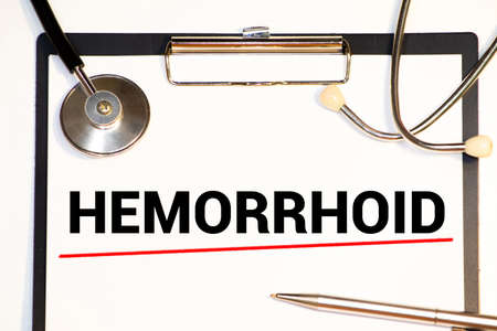 word Hemorrhoids on letter board. Medical concept. Minimal.