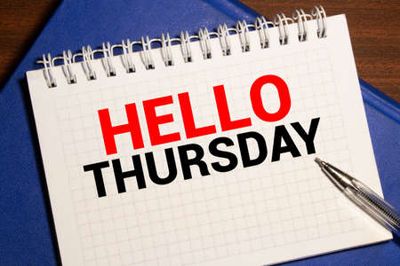 notebook with text HELLO THURSDAY, business concept Imagens