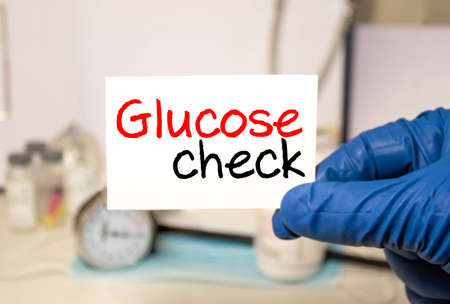 Glucose Level card in hands of Medical Doctor.