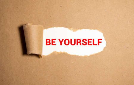 Torn paper revealing words BE YOURSELF, Idea for how to love yourself, Investing in knowledge.