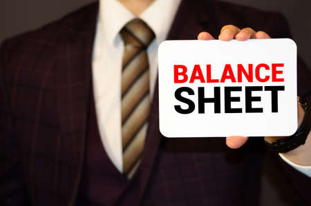 Businessman with BALANCE SHEET WORD. business concept Imagens