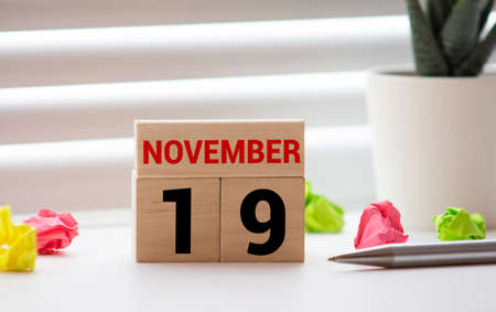 Wood blocks in box with date, day and month 19 November. Wooden blocks calendar.