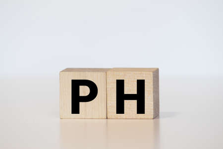 pH colorful word on the wooden background