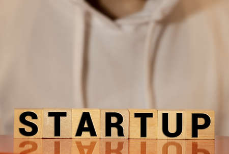 Wooden blocks with the word Startup.