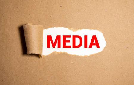 Word MEDIA Composed Of Guttenberg Original Metal Letters. Torn paper