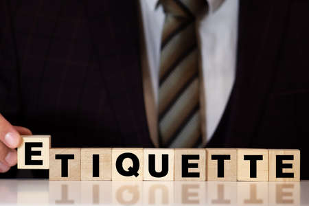 ETIQUETTE word made with building blocks, concept
