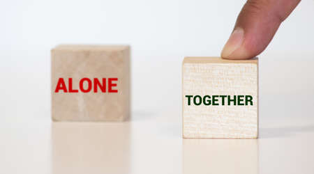 Work together and not alone - two little chalkboards with text on wooden background