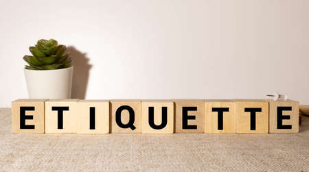 ETIQUETTE word written on wood block. ETIQUETTE text on wooden table for your desing, concept