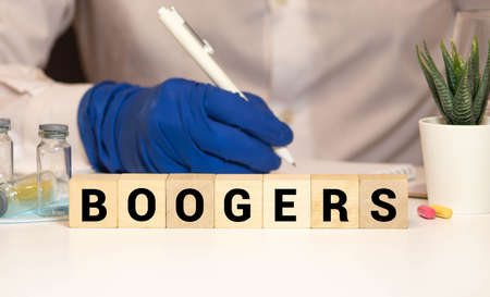 boogers colorful word on the wooden background with stethoscope Foto de archivo