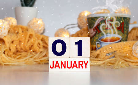 Cube shape calendar for January 01 on wooden surface with empty space for text
