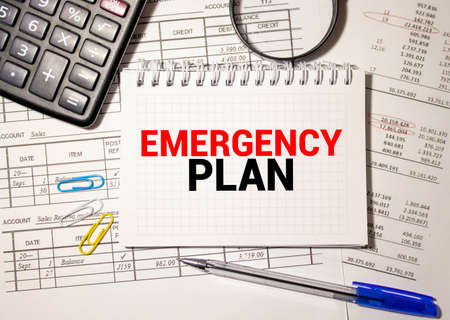 Handwriting Announcement text showing Emergency Plan. Business concept for Disaster Protection Written on tablet, wooden background with sticky note and pen