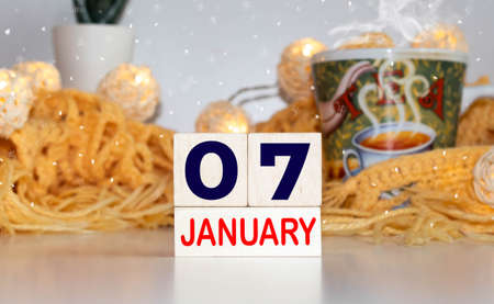 Cube shape calendar for January 07 on wooden surface with empty space for text Archivio Fotografico