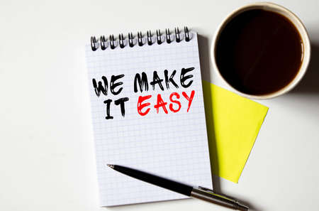 Make It Easy concept, handwriting on notebook with light bulbs. Stock fotó