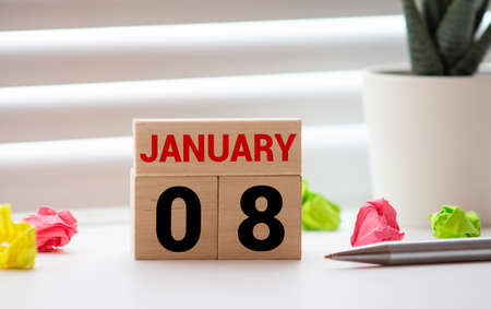 Cube shape calendar for January 08 on wooden surface with empty space for text