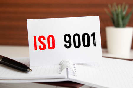 Iso 9001 text concept isolated over white background.