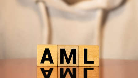 AML anti money laundering acronym on wooden blocks. Government policy and word economy concept Stock Photo