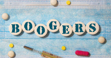 boogers colorful word on the wooden background with stethoscope.