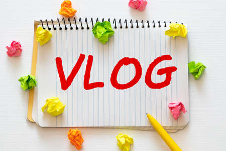 Word writing text Business Vlog. Business concept for A video content about subject matter related to the company Colored clothespin papers empty reminder yellow floor background office.