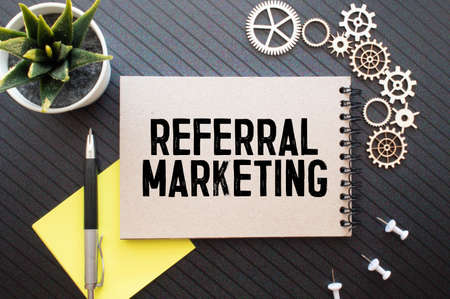 Notebook with Toolls and Notes about Referral Marketing, concept.