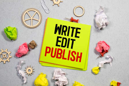 Conceptual hand writing showing Self Publish. Business photo showcasing Published work independently and at own expense Indie Author Paper notes Communicate ideas Markers Wooden background. Stockfoto