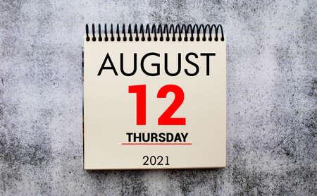 tear-off calendar sheet with date August 12.