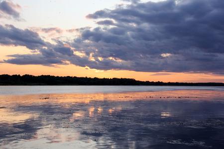 summer sunset in Latvia on river Daugava.