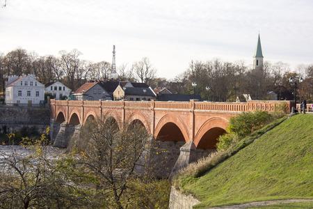 old Brick bridge across the River Venta in the city of Kuldiga Latvia