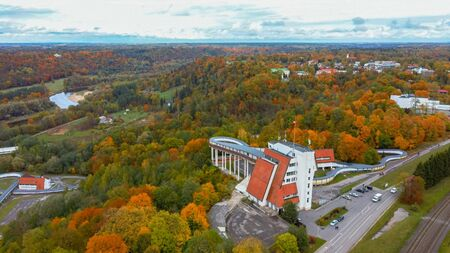 Autumn Landscape Aerial View of the Bobsleigh and Skeleton Track Luge Track Sigulda Surrounded by Colorful Forests During Golden Autumn Season in Latvia. Standard-Bild - 132159666
