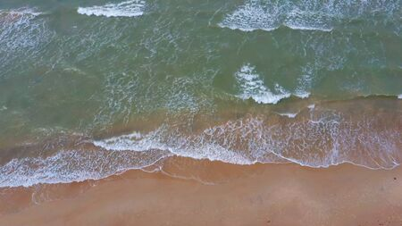 Aerial Dron Shot of the Baltic Sea Costline With Waves View From Above. Sea Waves Over a Sandy Beach.top View of Sea Waves Foaming and Splashing, Big Waves From Above Stock fotó