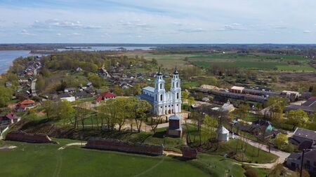 Aerial View of the Roman Catholic Church in Ludza, Latvia. Sunny Spring Day