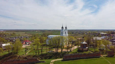 Aerial View of the Ludza Medieval Castle Ruins on a Hill Between Big Ludza Lake and Small Ludza Lake and the Roman Catholic Church in Background