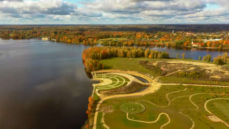 "Autumn Aerial Landscape Over the Garden of Destiny in Koknese, Open-air Park ""Liktendarzs"". Monumental Architectural Ensemble on the Daugava Island in Koknese. Golden Autumn Season in Latvia."