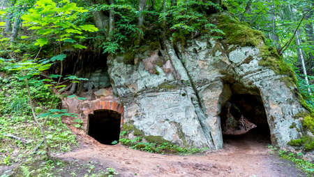 Anfabrika Rocks and Cellars in Ligatne Town an Old Floodgate Dam. Ancient Sandstone Caves and Ancient Chambers in Gauja National Park, Latvia