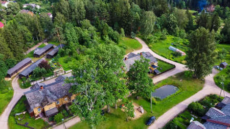 Old Wooden Houses Built for Paper Mill Workers in Ligatne. Wooden Row House Aerial Dron Shot Standard-Bild