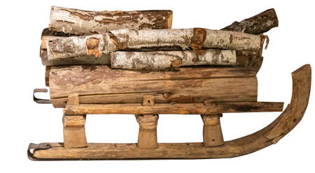 Real Antique Vintage Sled With Firewood. Isolated on White Background. Retro Style.