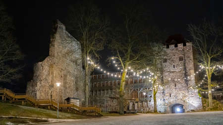 Ruins of Sigulda Medieval Castle, Latvia. Old Fortress Cristmas Time Night Shot.