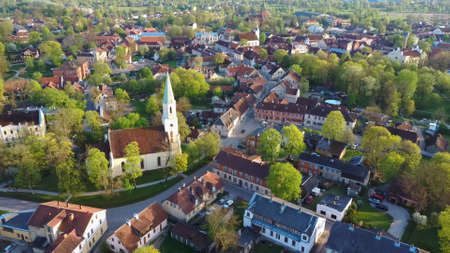 Aerial View of Kuldiga Old Town With Red Roof Tilesand Evangelical Lutheran Church of Saint Catherine in Kuldiga, Latvia. Stock Photo