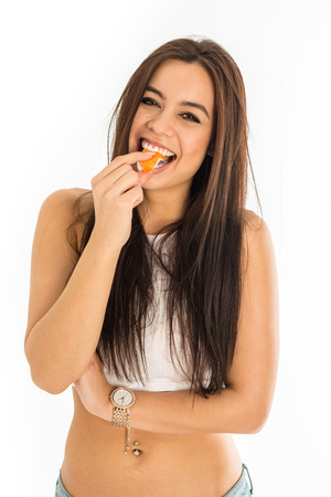 bellybutton: Young attractive asian caucasian woman holding sushi with her fingers, sexy fashion and pierced bellybutton, isolated on white background