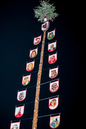 maypole: A german traditional maypole against night sky, Maibaum Stock Photo