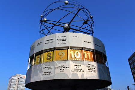 tardiness: An image of a clock - world clock - berlin