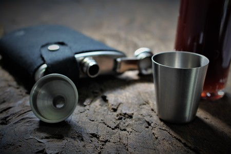 hip flask: An image of a flask - blurry background Stock Photo