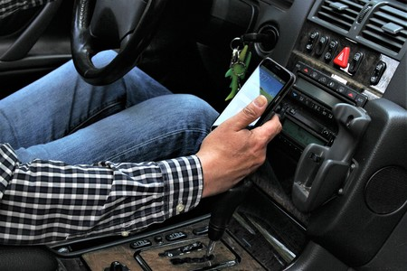 An image of car and mobile phone