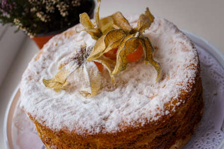 Incredibly Delicious Home Baked Cake. The Top Is Decorated With Edible Physalis Fruits.