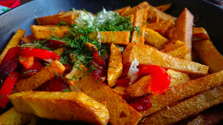 Slices Of Deep-fried Potatoes And Grilled Bell Peppers, Seasoned With Garlic And Dill Stock fotó