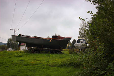 Motorboats removed from the water and put on a car trailer Reklamní fotografie